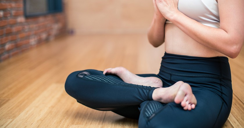 Meditating at the start of a yoga class