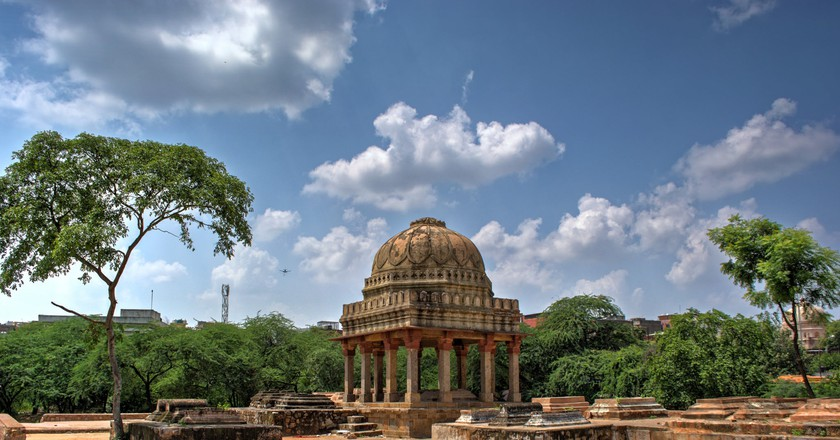 Take a scenic walk in Mehrauli Archaeological Park, which houses many ancient monuments