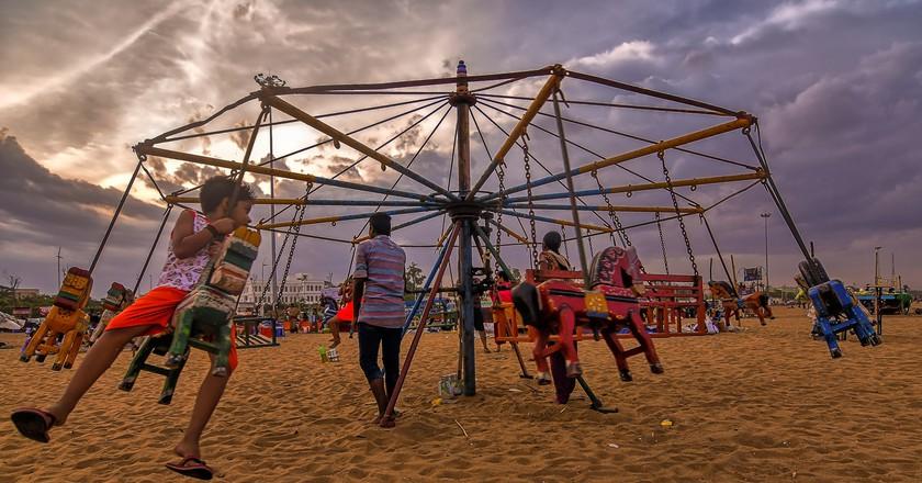 Children in Chennai enjoying a cloudy respite from the summer heat