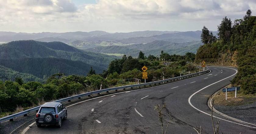 A car driving towards the Coromandel