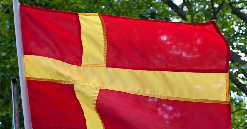 The Skane flag is everywhere across the region   © Håkan Dahlström / Flickr
