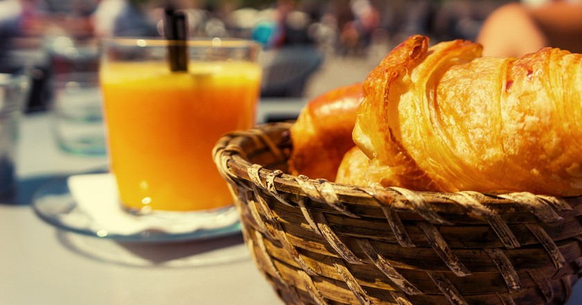 Freshly baked croissants and squeezed orange juice
