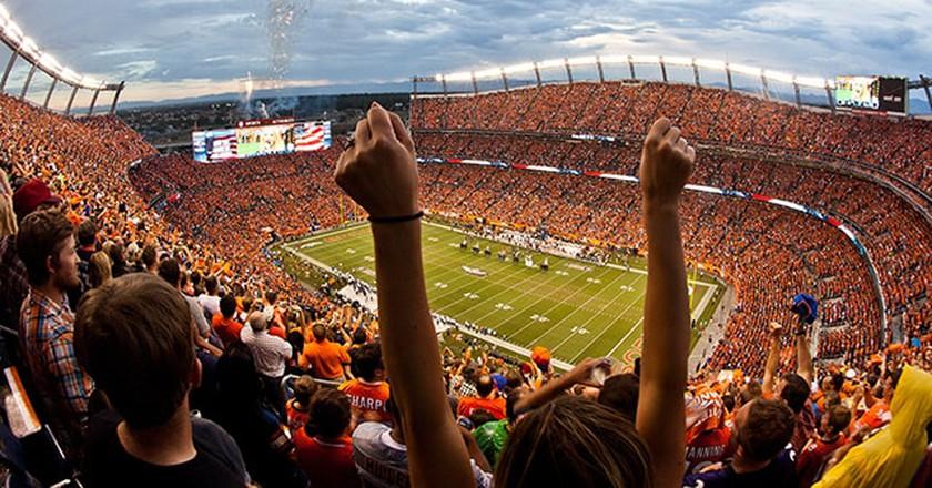 Denver Broncos fans cheer during a game