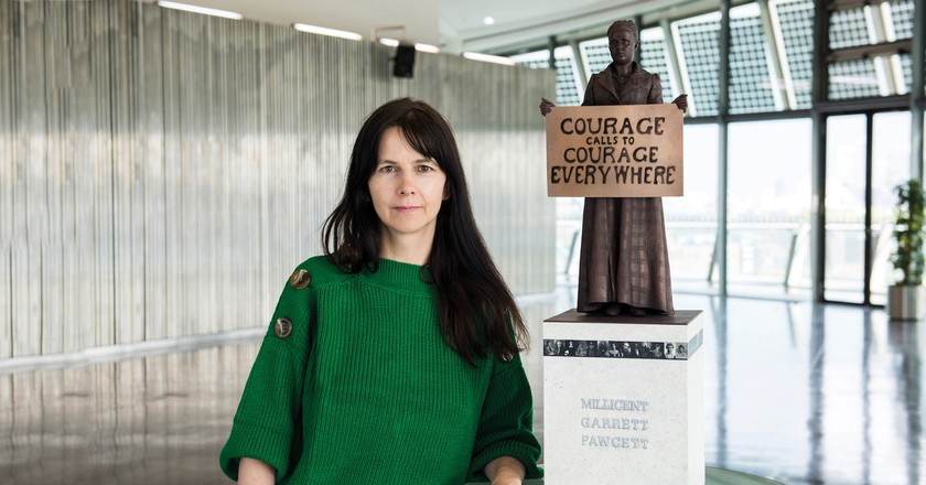 Gillian Wearing in front of a maquette of her Millicent Fawcett sculpture
