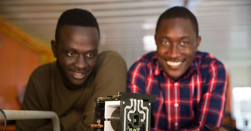 Brian Gitta (L) and Shafik Sekitto of thinkIT LTD with the device they invented