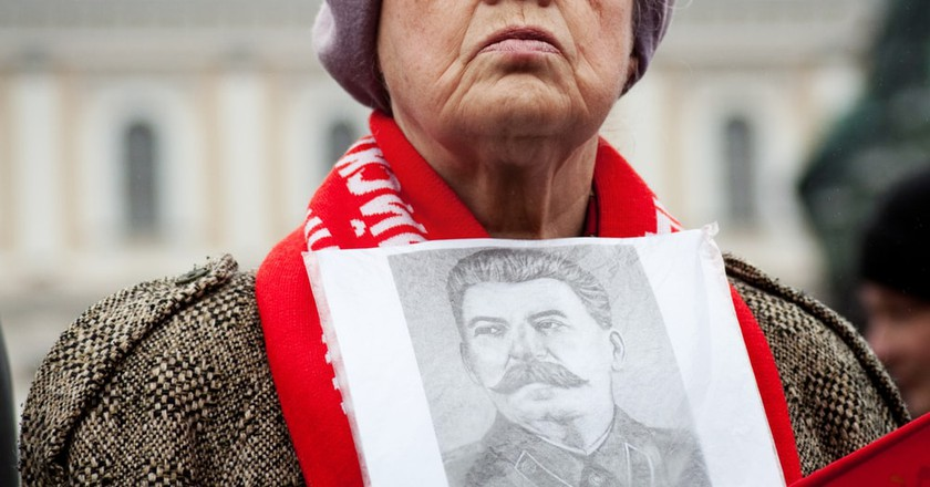 Woman takes part in the May Day Communist demonstration on May 1 in St. Petersburg, Russia
