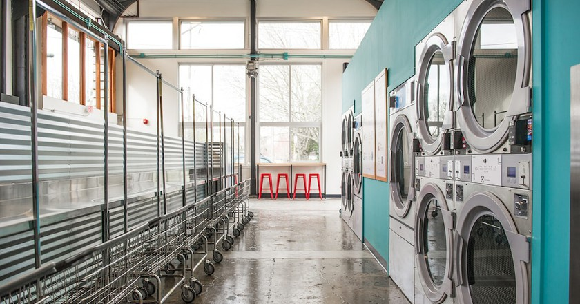 Spin Laundry Lounge is a sustainable laundromat that also serves as a bar and café