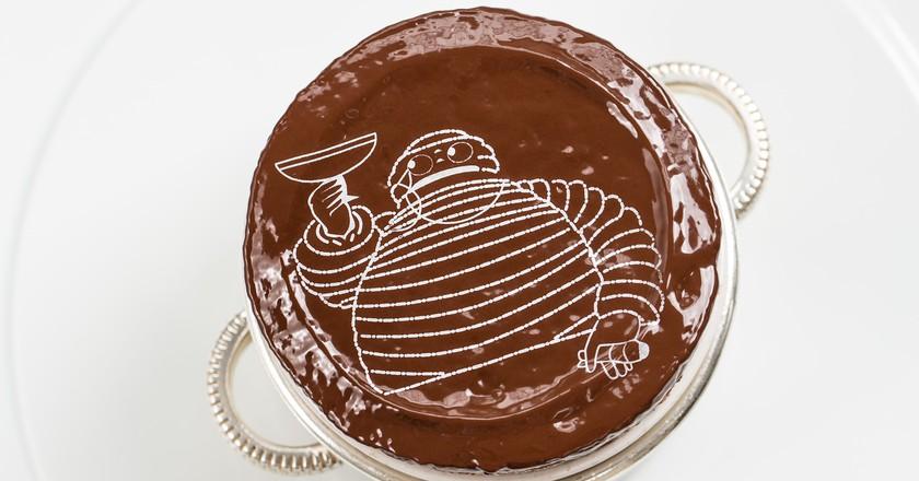 Michelin Man on the chocolate souffle at Bibendum