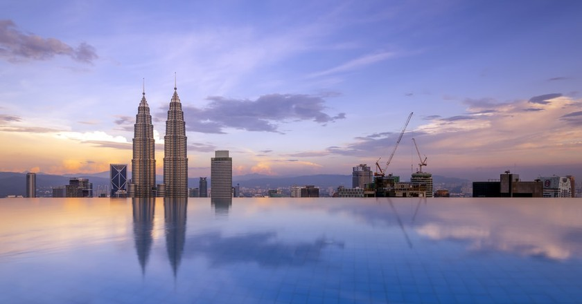 Reflection of Kuala Lumpur Twin Tower by the poolside