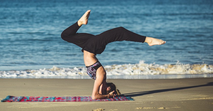 Try sunrise yoga on the beach at NY Fit Fest