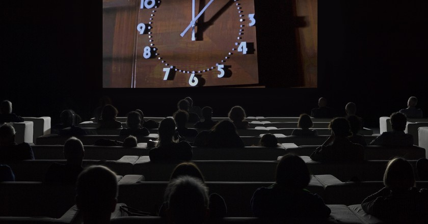 Installation view of 'The Clock' (2010) at Tate Modern, 2018