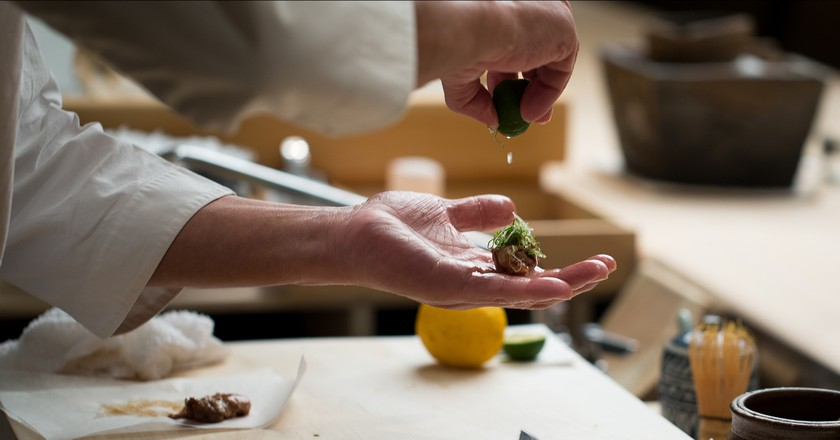 A chef works behind the scenes at Masa in New York