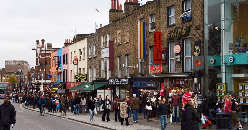 Crowds of people walk through Camden Lock, London