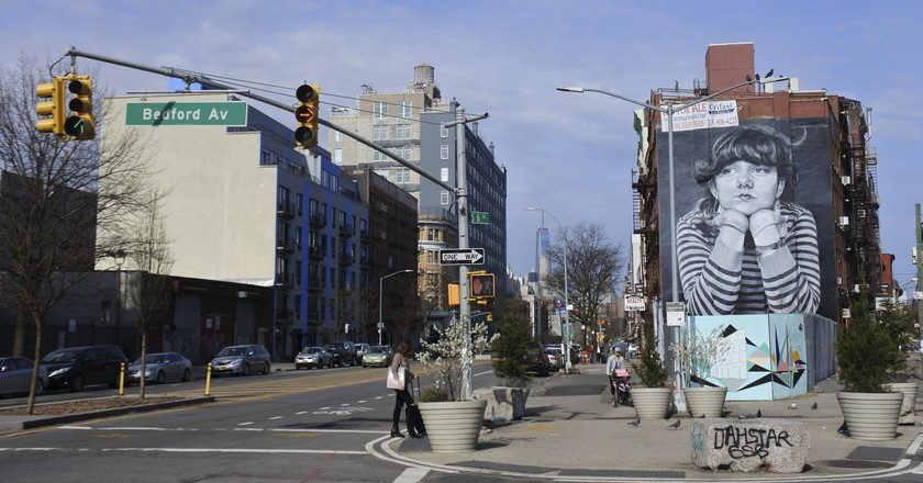 One World Trade Center looms on the horizon in this street scene from Williamsburg