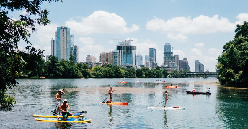People enjoy water sports in Austin on a beautiful day