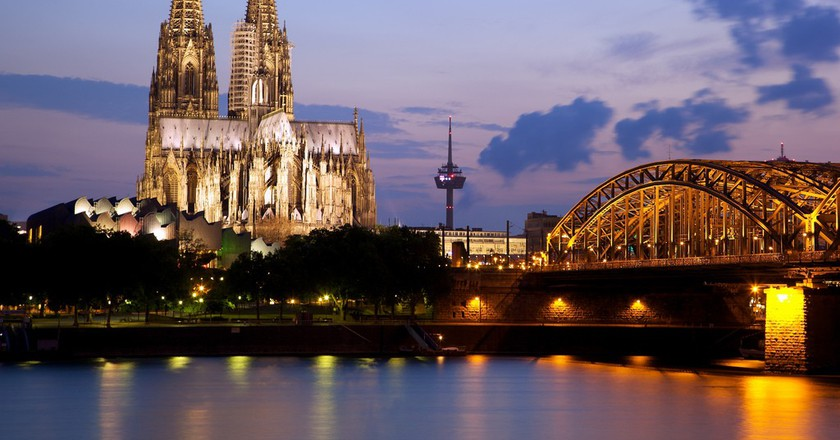 "<a href=""https://www.flickr.com/photos/jiuguangw/5943432110"" target=""_blank"" rel=""noopener noreferrer"">Cologne Cathedral and the Hohenzollern Bridge 