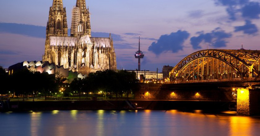 """<a href=""""https://www.flickr.com/photos/jiuguangw/5943432110"""" target=""""_blank"""" rel=""""noopener noreferrer"""">Cologne Cathedral and the Hohenzollern Bridge 
