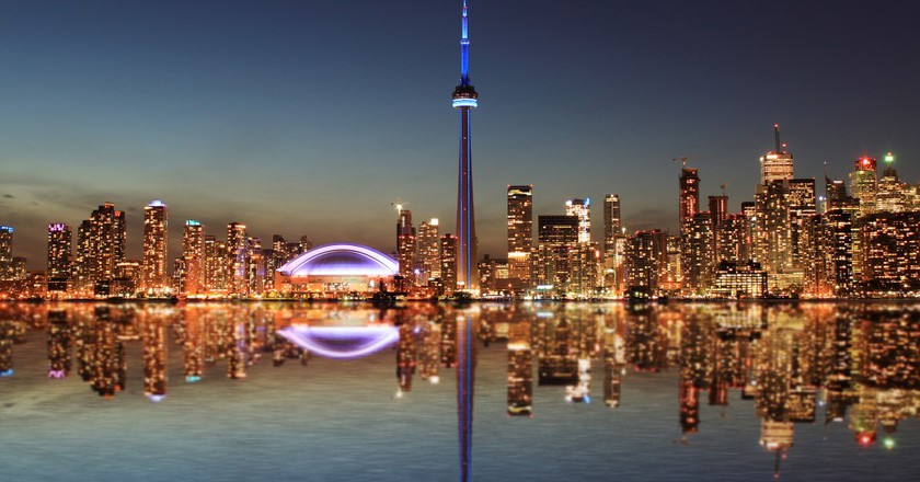 CN Tower - Toronto Skyline at night with a reflection in Lake Ontario | ©  Inga Locmele / Shutterstock