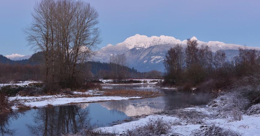 Pitt River and Golden Ears Mountain after sunset, Coquitlam, British Columbia © Lijuan Guo/Shutterstock
