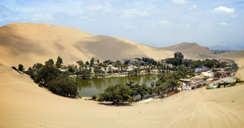 The Huacachina Oasis, in the desert sand dunes near the city of Ica, Peru ©Marktucan / Shutterstock