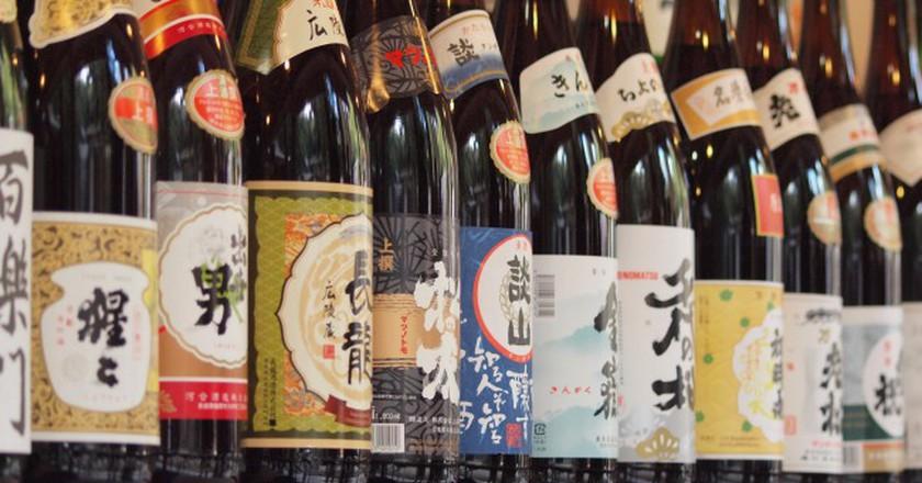 Sake (rice wine) dedicated to the shrine | © coniferconifer/Flickr