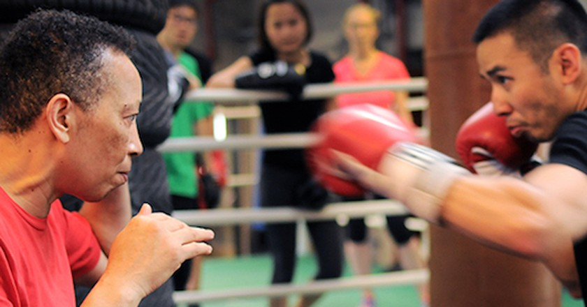 Michele Aboro, teaching boxing to student of the Aboro Academy. Explaining about to get the right distance,