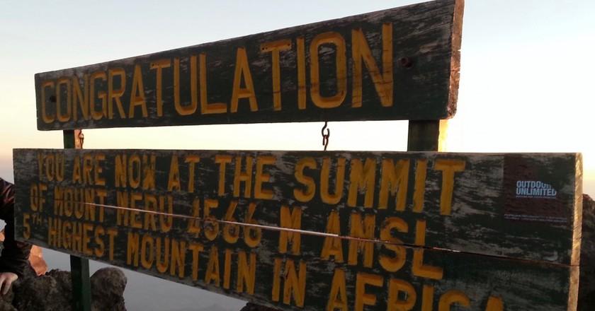Reaching the Summit: Photo courtesy of Amani Chomolla