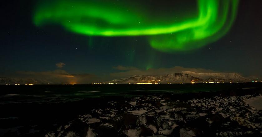Northern Lights over Reykjavik   © sergejf / Flickr