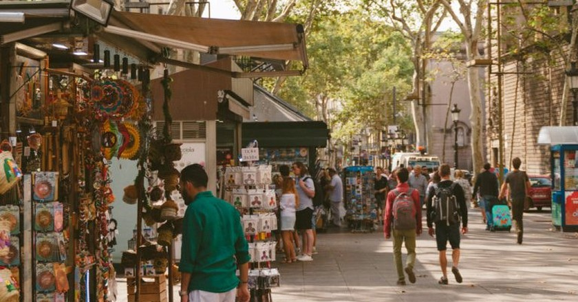 Tourists walking around Las Ramblas   Michael & Tara Castillo / © Culture Trip