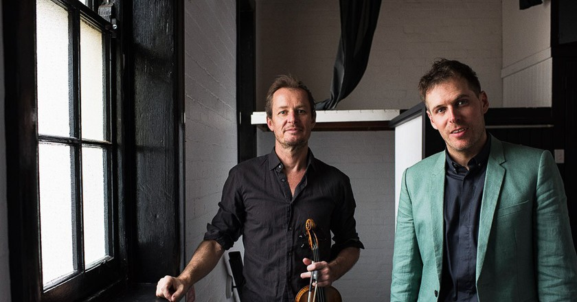Director of the Australian Chamber Orchestra, Richard Tognetti and Director of Synergy, Timothy Constable, sit for a portrait in Tognetti's home, in Manly, Sydney.