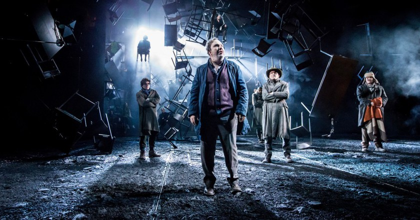 A scene from As You Like It, foreground Paul Chahidi (Jaques)   © Johan Persson
