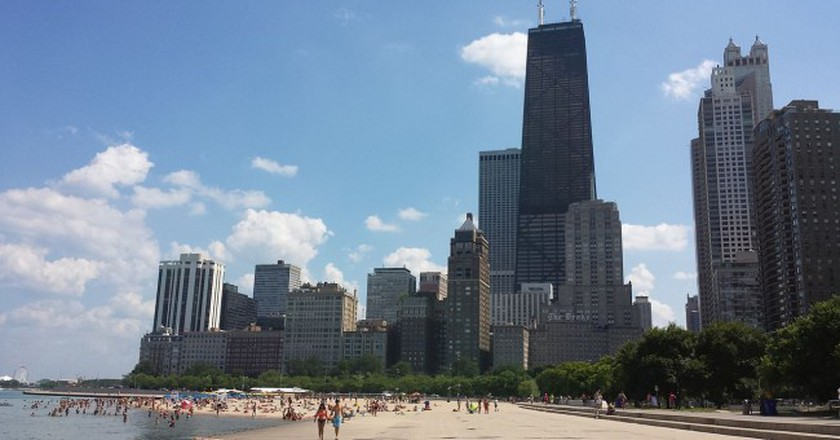 Oak Street Beach offers up hot, sandy fun with a towering backdrop.