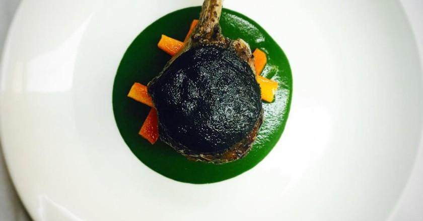 Lomo de Cordero con Trompetas de la Muerte y Zanahorias  Roasted Lamb Loin with Black Trumpets Mushrooms and Carrots   Image Courtesy of Ananda 141
