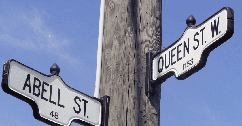 Street signs for Queen Street West and Abell Street | GTD Aquitaine