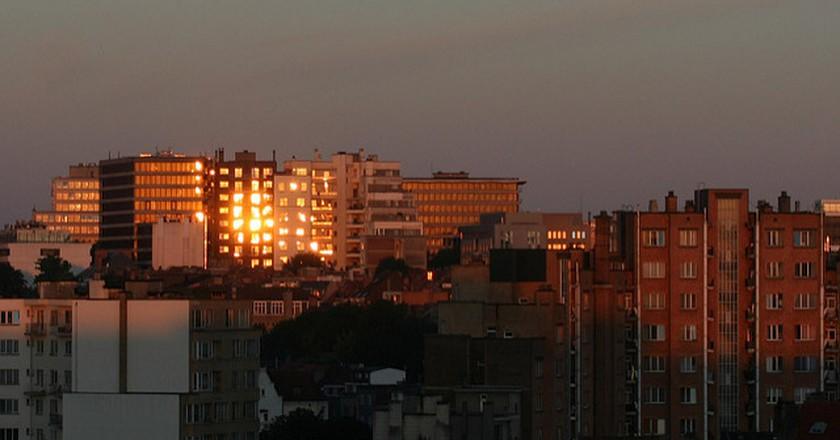Sunrise reflections on buildings of Avenue Louise, Ixelles, Belgium | © Philippe Teuwen/Flickr