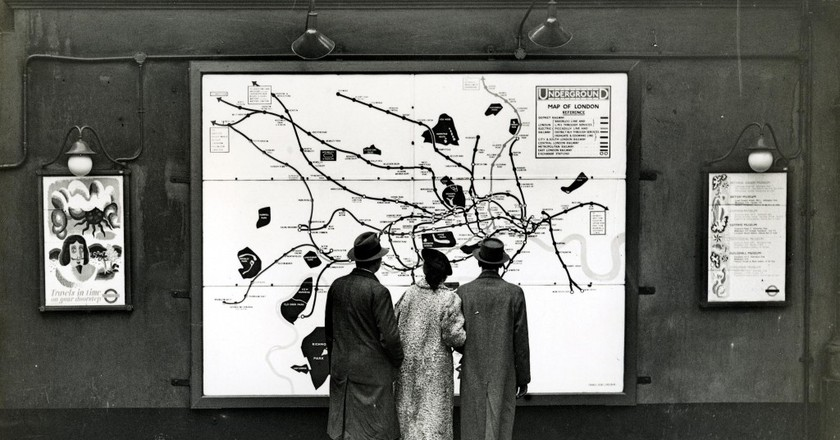 Passers-by at Strand Underground station |  Courtesy of London Transport Museum