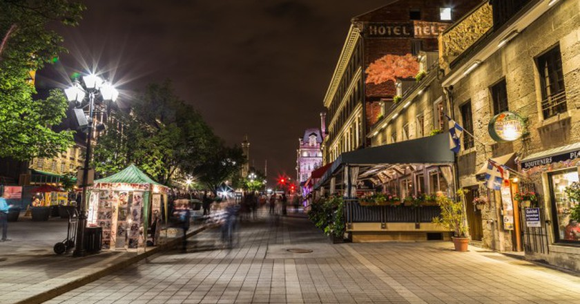 Old Town Montreal at night showing the blur of people | © Mikecphoto / Shutterstock