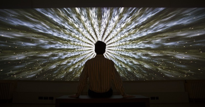 A visitor views 'Beyond the Infinite', 2016, by artist Doug Foster at the exhibition Daydreaming with Stanley Kubrick in partnership with Canon at Somerset House in London. Photo by Peter Macdiarmid | © London News Pictures/LPN