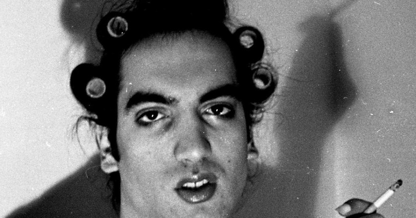 """Reproduction of Diane Arbus' """"A young man with curlers at home on west 20th street""""picture, shot on 35 mm film developped the old fashion way 