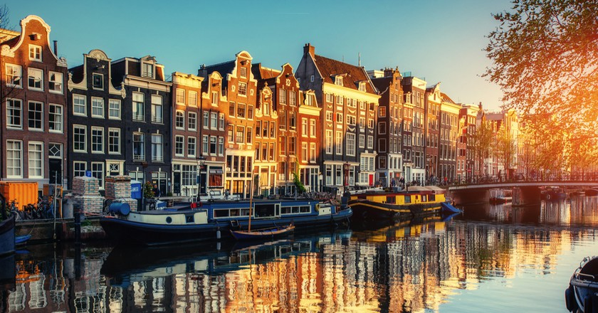 Reflections in an Amsterdam canal   © Standret/Shutterstock
