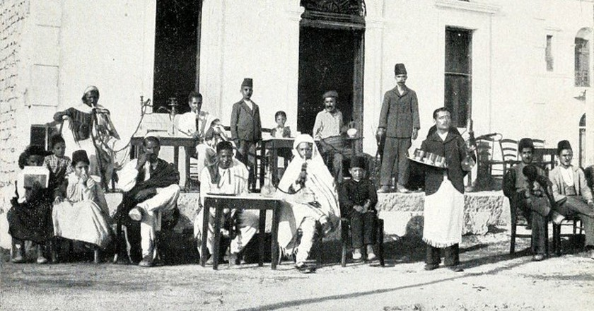 "Men only at an Ottoman coffee house in Libya. |Source: ""Tripolitania"" by Domenico Tumiati 1911"