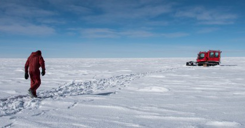A member of the Concordia team walks across the Antarctica Ice| © Beth Healey