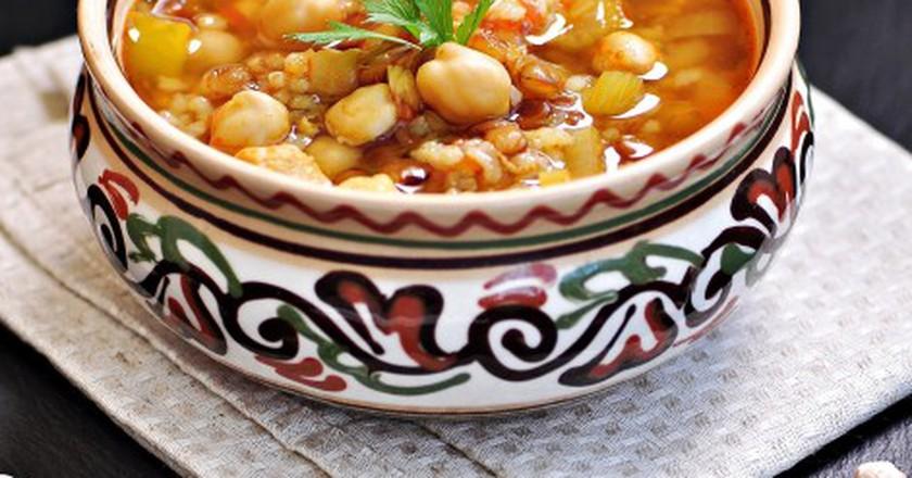 Moroccan harira soup in a traditional bowl/ © Tanya Chudovska/Shutterstock