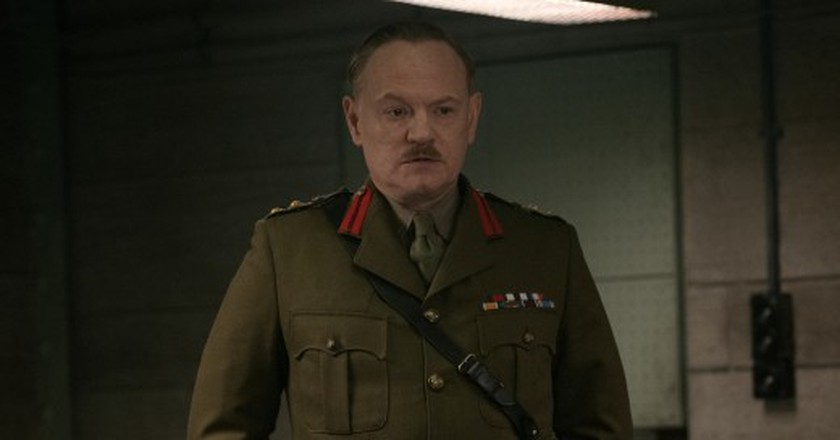 Jared Harris plays Heslop in Allied from Paramount Pictures.