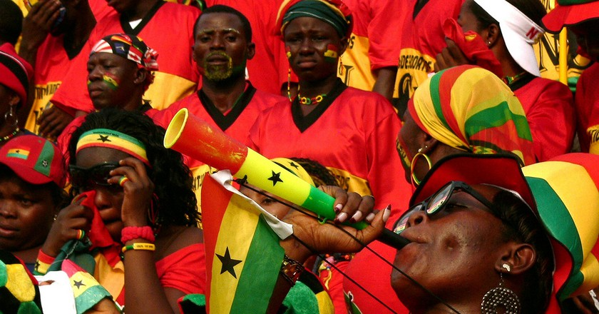 A member of the NSU making some noise during Ghana's opening game against Guinea. | © Jake Brown/flickr.com