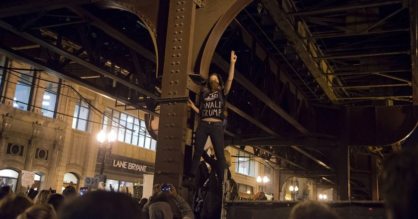 A woman protests the election of Donald Trump in Chicago