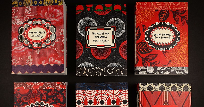 The six colorful new Vintage editions of Russian classics, made from Russian textiles, set in Russian textiles. | Courtesy of the publisher