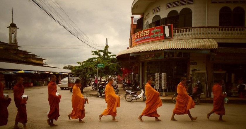 Monks on their morning collection of offerings in Battambang, Cambodia