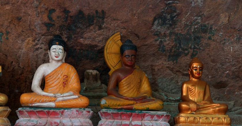Some Buddhist statues at the base of Wat Preah Ang Thom  © Steve Estvanik/ Shutterstock