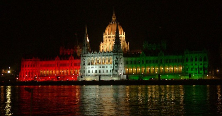 """<a href=""""https://commons.wikimedia.org/wiki/File:Parliament_of_Hungary_in_national_colours.JPG"""">Hungarian Parliament lit up in national colours 